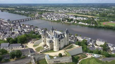 век : Aerial view of Castle and Loire Valley, France.Saumur Castle was built in the tenth century and rebuilt in the late twelfth century Стоковые видеозаписи