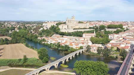 roussillon : Aerial view of Beziers city with St Nazaire Cathedral and old bridge Stock Footage