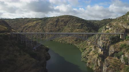 назад : Fast aerial view of iron bridge over canyon in Zamora, Spain