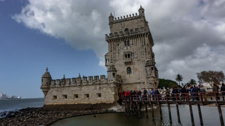 belem : Blurred timelapse of Belem tower and tourist row at the riverside of Tejo River
