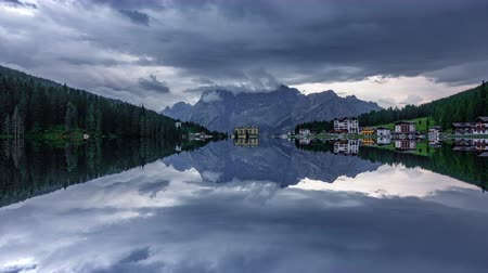 irreal : Starting to rain time lapse in Misurina lake perfectly reflected