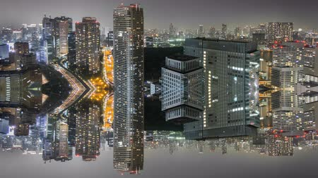 irreal : Night Time-Lapse reflection of downtown in Tokyo