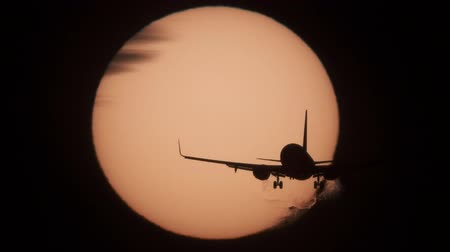 sun down : Jet approaching to landing with sun behind it Stock Footage