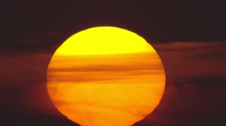 another : Huge orange sun with clouds, fast sunrise