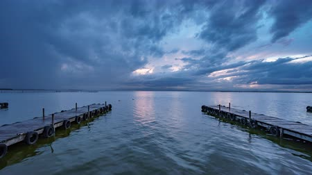 paralelo : Albufera wooden pier with tourists timelapse at dusk