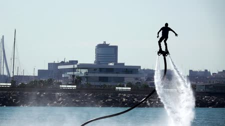 participante : Silhouette of a Man Having Fun on Flyboard with Valencia in the background