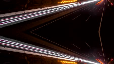 vanishing point : Fast car lights in the highway, loop-ready reflected time lapse
