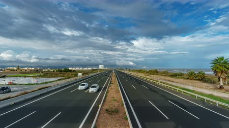 daily : Top view time lapse of freeway near sea