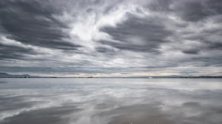 benzer : Albufera rice fields flooded with cloudscape