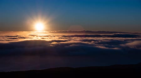 Spectacular timelapse of sunset over the clouds