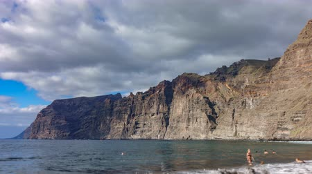Time lapse of Los Gigantes cliffs and beach in Tenerife Стоковые видеозаписи