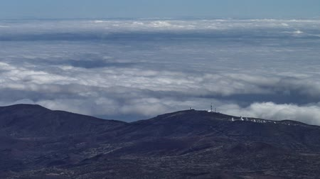 Teide Observatory over the clouds timelapse, Tenerife, Spain