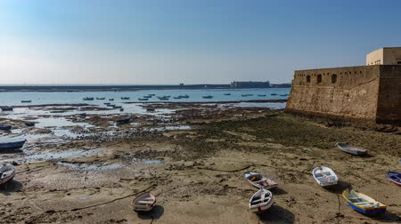 Cadiz fort and boats near beach timelapse Stock Footage