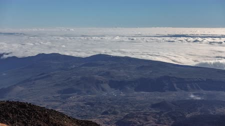 speck : Teide Observatory over the huge wave clouds timelapse, Tenerife, Spain
