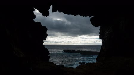 blindness : Lava cave hole to the pacific ocean in Rapa Nui Stock Footage