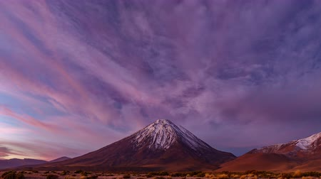 アセント : Licancabur high volcano time lapse at sunset with pink sky