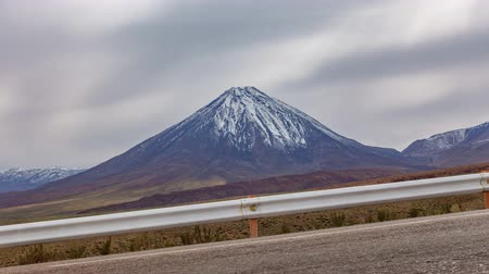 ограждение : High slope road and Licancabur volcano time lapse Стоковые видеозаписи