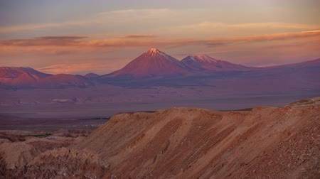 pinky : Licancabur high volcano time lapse with full moonrise at sunset with pink sky