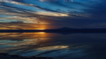salt lagoon : Sunset falling over Atacama salar and Chaxa lagoon reflection