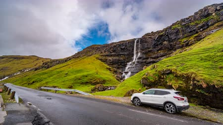 conquest : Road, car and waterfall time lapse, wide angle