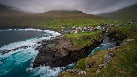 entire : Gjogv gorge and town on the island of Eysturoy in the Faroe Islands. TIme lapse