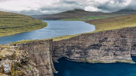 cheat : Time lapse of Sorvagsvatn lake over the cliffs of Vagar island, Faroe Islands