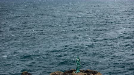 mítosz : Time lapse of Faroe islands coastline with statue