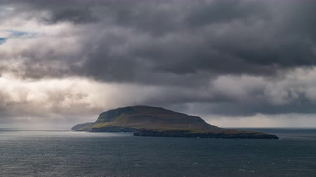 habitable : Isolated steep island time lapse with dark clouds Stock Footage