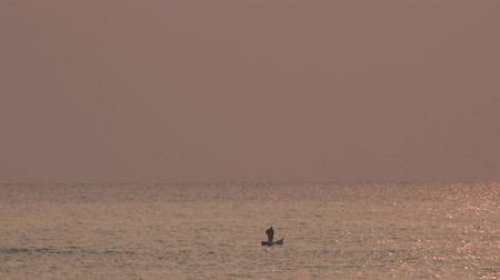 copyspace : Fisherman in Lake Malawi at sunrise