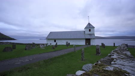 run down : Olaf church sliding camera in Faroe Islands Stock Footage