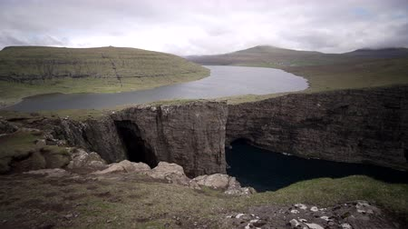 flying sea gull : Sorvagsvatn lake over the cliffs of Vagar island establishing shot, Faroe Islands