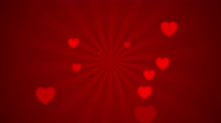 art : Abstract red rays and blurred hearts. Valentines day video animation