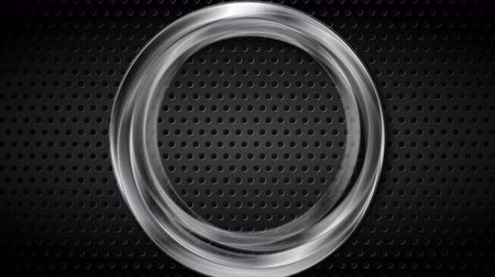 átlyukadt : Silver metallic ring on black perforated background video animation