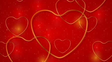 art : Golden glitter hearts and dots on red background video animation