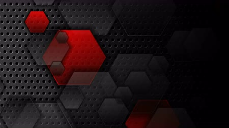 átlyukadt : Red and black hexagons on dark perforated background video animation Stock mozgókép