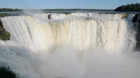 national park : Devils Throat (Garganta del Diablo) is the biggest of the Iguazu Waterfalls timelapse. Iguazu Falls located on the Iguazu River on the border of the Argentina and the Brazil.