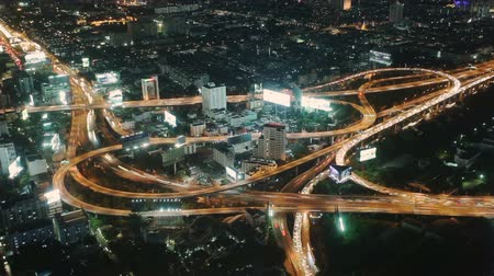 Night traffic at road junction timelapse in Bangkok, Thailand