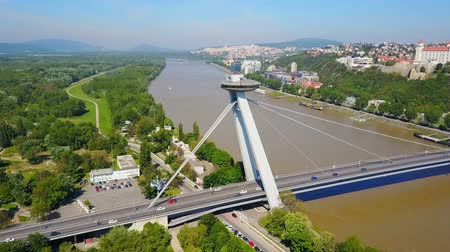 Словакия : Most SNP new bridge or UFO Bridge or Novy Most aerial panoramic view in Bratislava, Slovakia. SNP Bridge is a road bridge over the Danube river. Стоковые видеозаписи