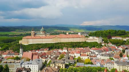 austrian : Melk Abbey Monastery aerial panoramic view. Stift Melk is a Benedictine abbey in Melk, Austria. Monastery located on a rocky outcrop overlooking the Danube river and Wachau valley.