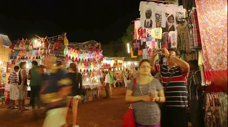 flee : GOA, INDIA - FEBRUARY 22: Tourists on Goa night market timelapse on February 22, 2014, Goa, India Stock Footage