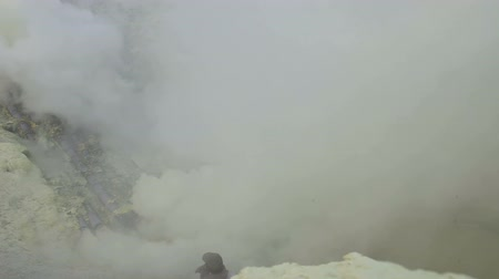 Sulfur miners inside crater of Ijen volcano in East Java, Indonesia timelapse. Stok Video