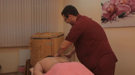 massager : man phyto barrel, electronic foot massage, tea ceremony Stock Footage