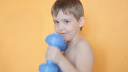 a little boy works out the punches in boxing Wideo