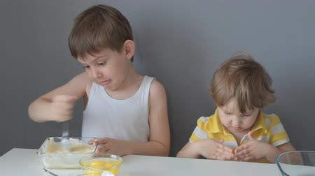 children prepare dough for cookies Stockvideo