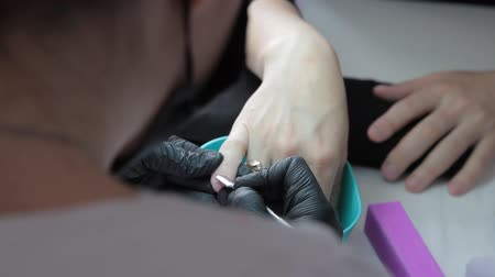 professional manicurist doing manicure to a woman Stockvideo