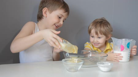 rejoice : Children knead the dough. Add flour, sugar, eggs, butter