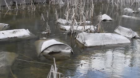 chernobyl : iron old radioactive barrels lie in the river and pollute the environment