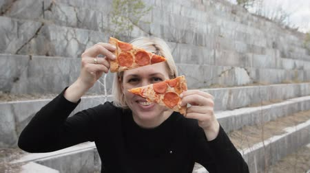 cheerfulness : beautiful woman improvises with pizza on a marble background Stock Footage