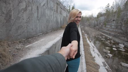 pedreira : blonde woman leads him by the hand behind him Stock Footage
