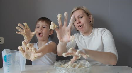 regozijo : Mother and son hands knead the cookie dough Stock Footage